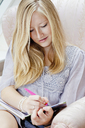 A teenage girl writing in her diary - FSIF00381