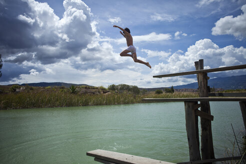 A young boy jumping into a lake - FSIF00420
