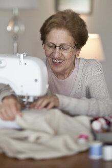 A senior woman sewing - FSIF00429