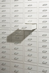 A white cabinet of drawers with one drawer open - FSIF00660