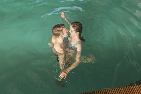 High angle view of passionate couple in swimming pool - FSIF00942