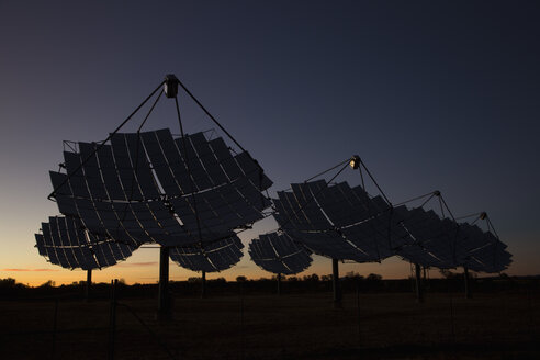 Solar dishes at power station against sky during sunset - FSIF00978