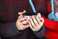 Midsection of young couple holding coffee cup during winter - FSIF00993