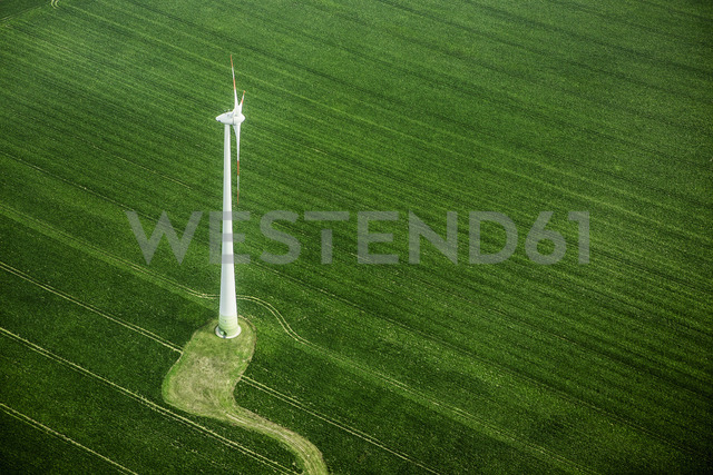 High angle view of wind turbine on green landscape - FSIF01002