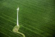 High angle view of wind turbine on green landscape - FSIF01002