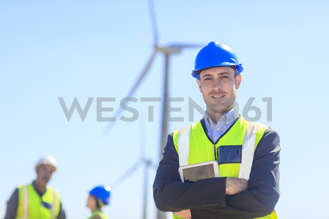 Portrait of confident businessman wearing reflective vest on a wind farm - ZEF14956