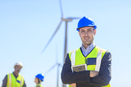Portrait of confident businessman wearing reflective vest on a wind farm - ZEF14956