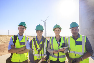 Portrait of four smiling engineers on a wind farm - ZEF14974
