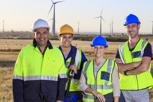 Portrait of four smiling engineers on a wind farm - ZEF14983