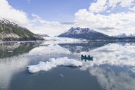 People rafting in glacier lagoon against sky, Lake George, Palmer, Alaska, USA - FSIF01129