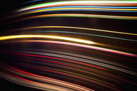 Full frame abstract image of various light trails against black background - FSIF01192