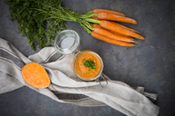 Glass of sweet potato carrot soup garnished with chives - LVF06696