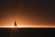 Silhouette of yacht in sea against sky during sunset - FSIF01301