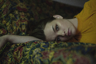 Portrait of beautiful young woman lying on bed - FSIF01331