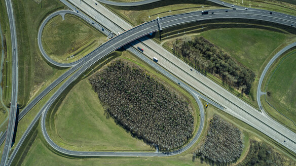 Aerial view of highways in field during sunny day, Berlin, Brandenburg, Germany - FSIF01355