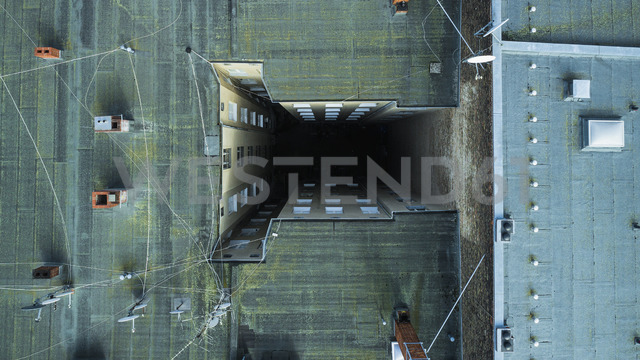 Aerial view of apartment building rooftop in city, Berlin, Germany - FSIF01358