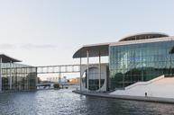 Germany, Berlin, Regierungsviertel, Paul-Loebe-Building and Marie-Elisabeth-Lueders-Building at Spree river in the evening - GWF05437