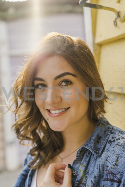 Portrait of smiling young woman at backlight - AFVF00030