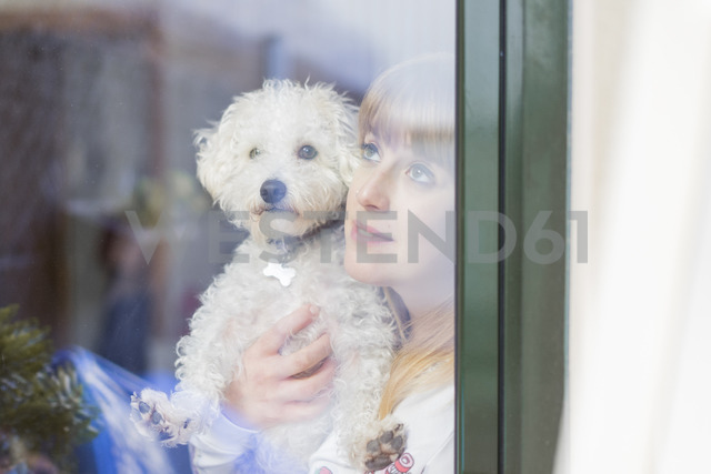 Woman and her dog looking out of window - AFVF00088