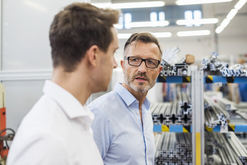 Two businessmen discussing in factory - DIGF03378