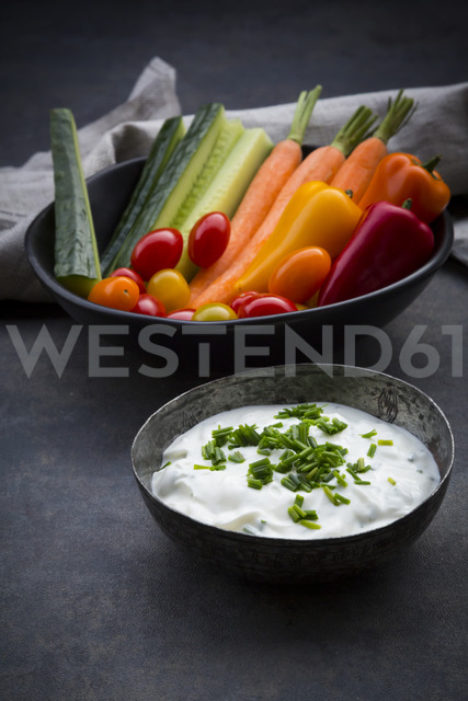 Bowl of chive dip, cherry tomatoes and various vegetable sticks - LVF06718