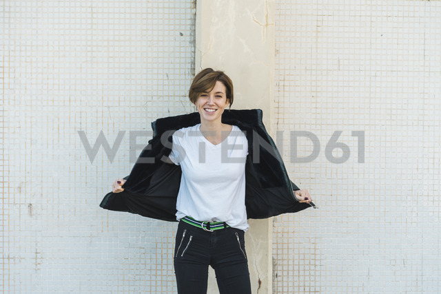 Portrait of relaxed woman taking off her jacket - AFVF00097