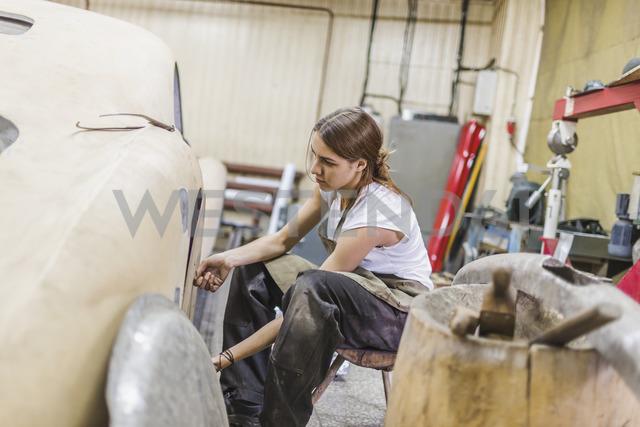 Female mechanic repairing car at repair shop - FSIF01415