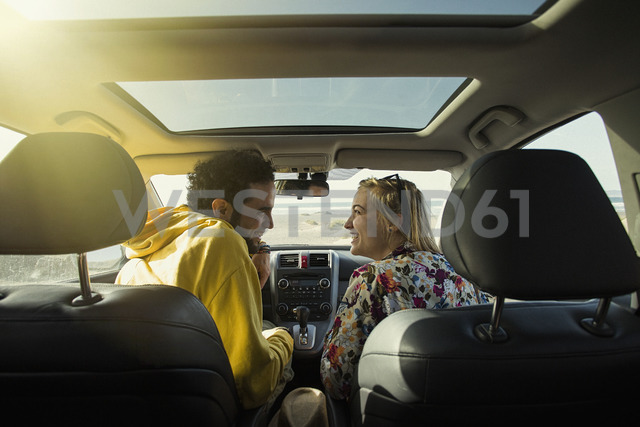 Rear view of happy couple looking at each other in car - FSIF01598 - fStop/Westend61