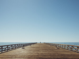 Pier over sea against clear blue sky - FSIF01814
