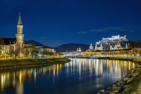 Austria, Salzburg State, Salzburg, Old town, Salzach river, Hohensalzburg Castle and Christ church at night - YRF00207