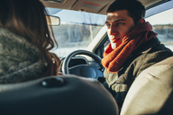 Young woman staring at woman in car - FSIF01862