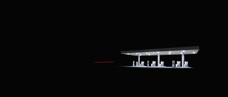 Illuminated gas station at night - FSIF01880