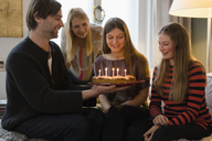 Happy family with birthday cake at home - FSIF01922