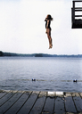A girl jumping into a lake - FSIF02003