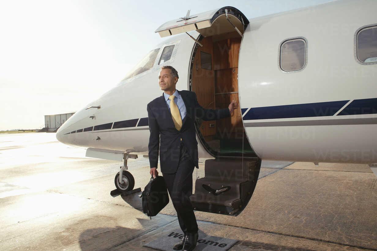 Businessman boarding a private airplane - FSIF02048 - fStop/Westend61