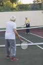 Senior men playing tennis at court - FSIF02162