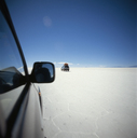 SUV's driving across salt flat, Salar de Uyuni, Bolivia - FSIF02351
