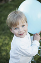 Young boy holding a blue balloon - FSIF02381