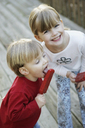 A boy and a girl eating popsicles in a back yard - FSIF02384
