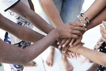 Group of multiethnic people, hands, together - IGGF00427