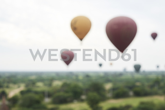 Myanmar, Bagan, blured view of many hot air balloons - IGGF00433