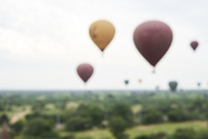 Myanmar, Bagan, blured view of many hot air balloons - IGGF00433