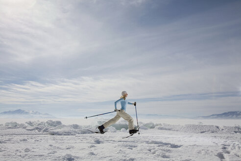 A woman snowshoeing - FSIF02475