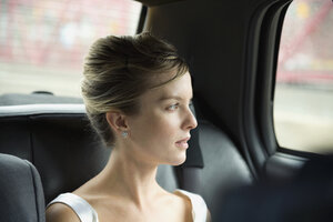 A bride sitting in a car - FSIF02502