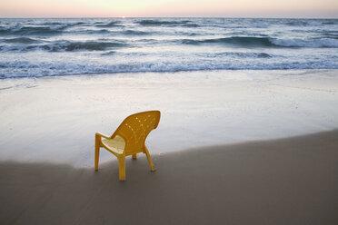 A plastic chair on the beach - FSIF02565