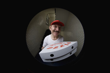 A pizza delivery man, viewed through peephole - FSIF02604
