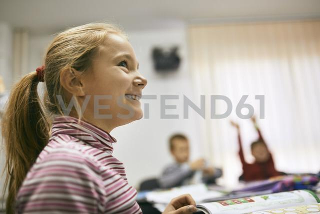 Portrait of smiling schoolgirl in class - ZEDF01217