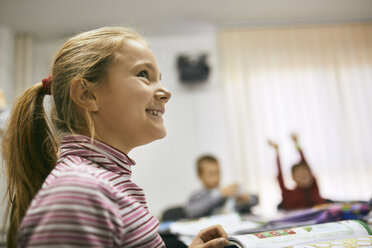 Portrait of smiling schoolgirl in class - ZEDF01217