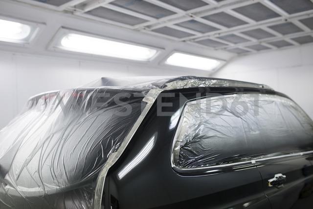 Car inside a paint booth in a repair garage - RAEF01969