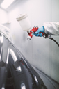 Auto painter painting a car - RAEF01975